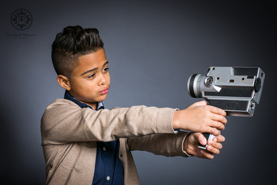 ©Richard Rosario Photography -Kid Model doing a Selfie with old camera
