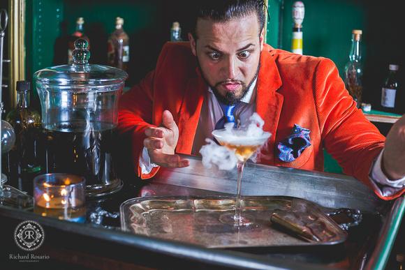 Baron Ambrosia mixing a drink at his bar