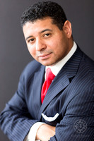 Headshot of Latin Man in Blue Pinstriped Suit and Red Tie